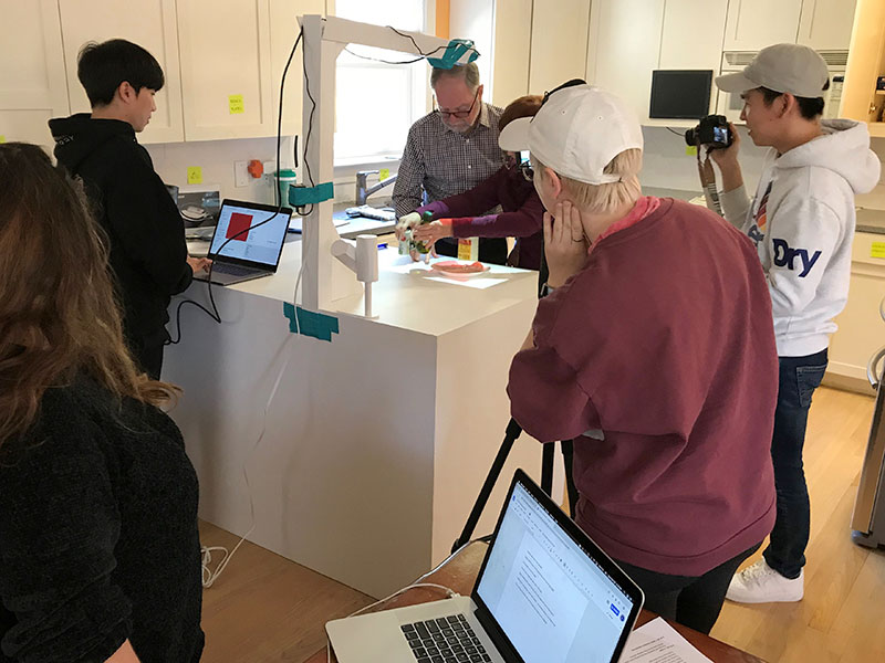 A client uses a test kitchen for people with MCI.