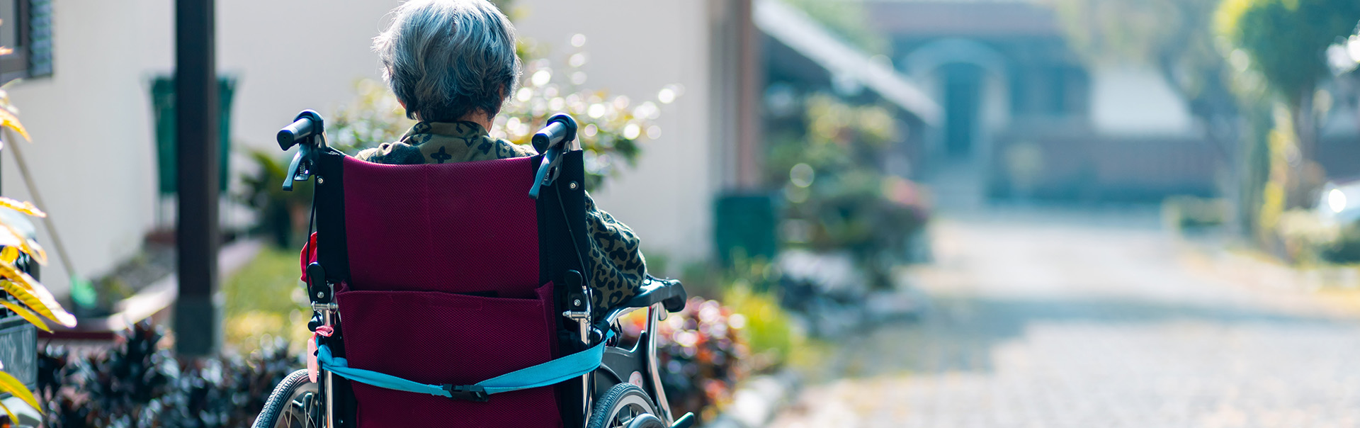 Woman in a wheelchair in an outdoor space.
